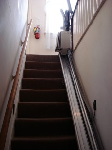 Back stairs off the kitchen with chair lift.